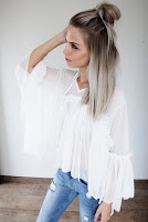 https://www.ellemillashop.com/a-48685460/welcome/vera-white-blouse/