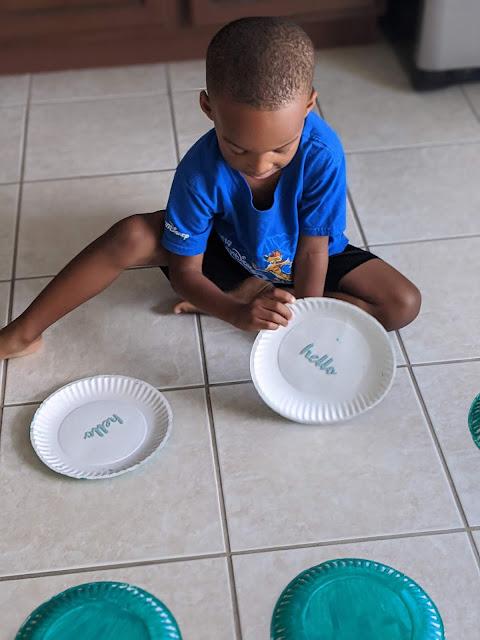 young boy playing diy spring matching game