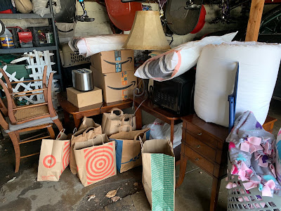 A pile of supplies, furniture and other goods that were donated to help furnish an apartment.