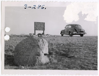 Lot 045 v3p47.3-286, View of the Syveruds' automobile at the Writing Rock State Park in Divide County, North Dakota. Writing Rock No. 1 is in the foreground