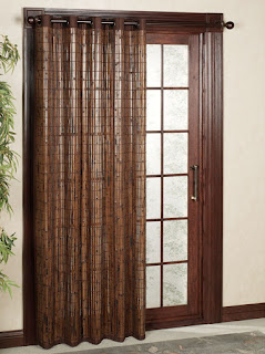 unique brown curtain drapes sliding glass door plus decorative indoor plant and pottery rug
