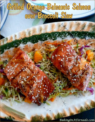 Grilled Orange Balsamic Salmon over Broccoli Slaw, a fast and easy dinner. Salmon is marinated, grilled, and served over a broccoli slaw dressed with the same marinade. | Recipe developed by www.BakingInATornado.com | #recipe #dinner