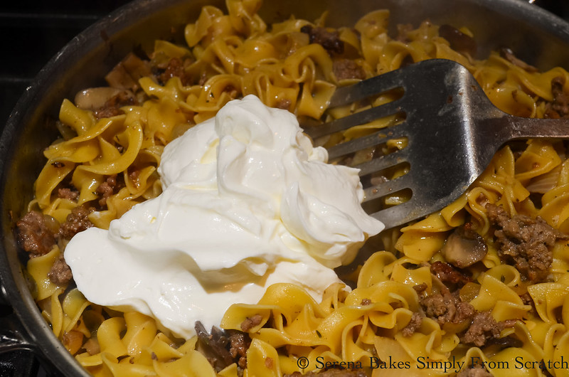 Stir sour cream into noodles to make Hamburger Beef Stroganoff.