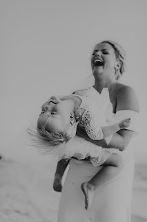Candid laughter photographs of bride and flower girl