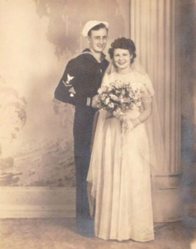 Wedding Photograph of man in US Navy uniform and woman in wedding gown