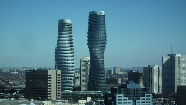 Photo of topped out towers and surrounding buildings