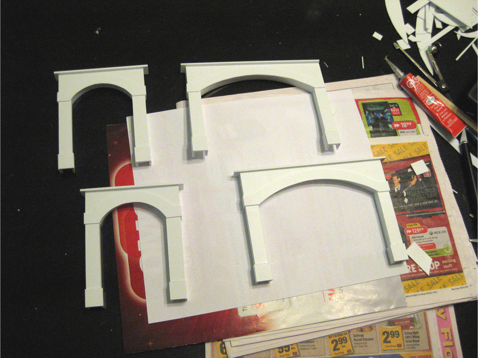 2 single and 2 double wide styrene tunnel portals with final arch details installed on the front faces