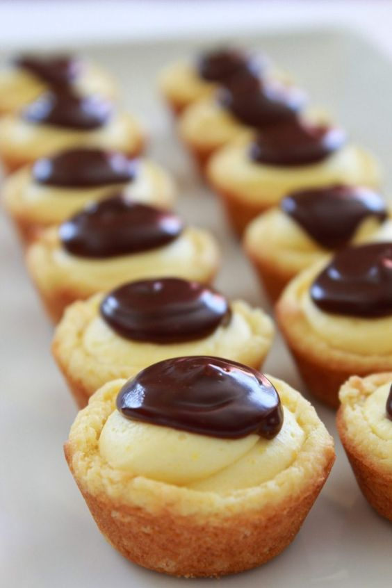 All of the awesome flavors you love from the traditional Boston Cream Pie are turned into a cookie bite. They are quick to make, starting with a cake mix and instant pudding. Everyone will go crazy…