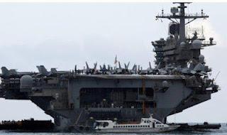 حاملة طائرات أمريكية نووية تطلب العزل الصحي !