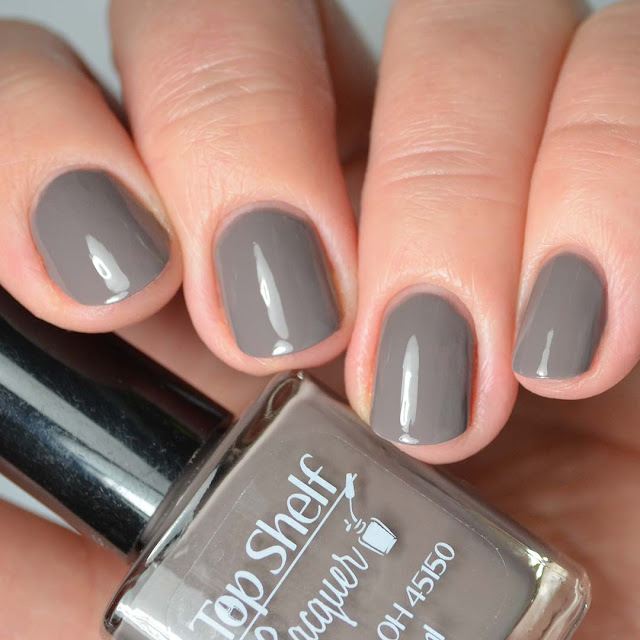 brown nail polish four finger swatch