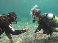 diver refreshes scuba skills in water with instructor
