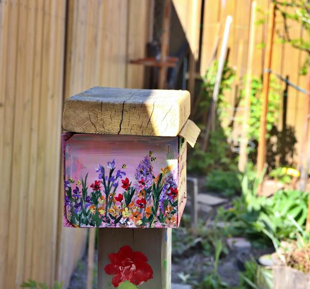 summer pollinator garden bee hotel