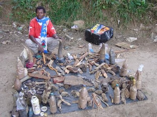 Traditional healer in Malawi - with treatments for sexually transmitted diseases after circumcision.