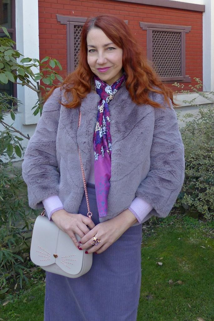 lavender faux fur coat with lilac corduroy skirt