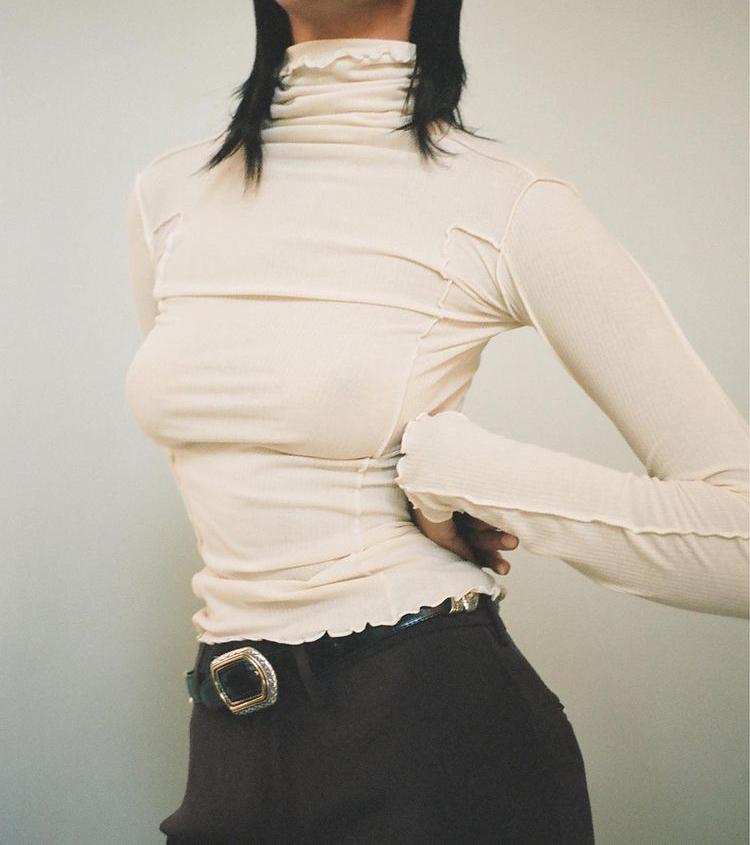 Ruffled blouse by Maimoun NY.