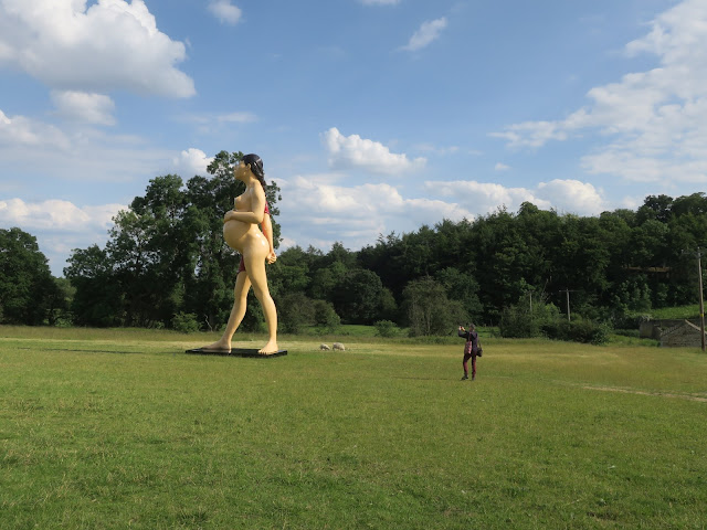 'The Virgin Mother' statue by Damien Hirst with photographer. Yorkshire Sculpture Park.