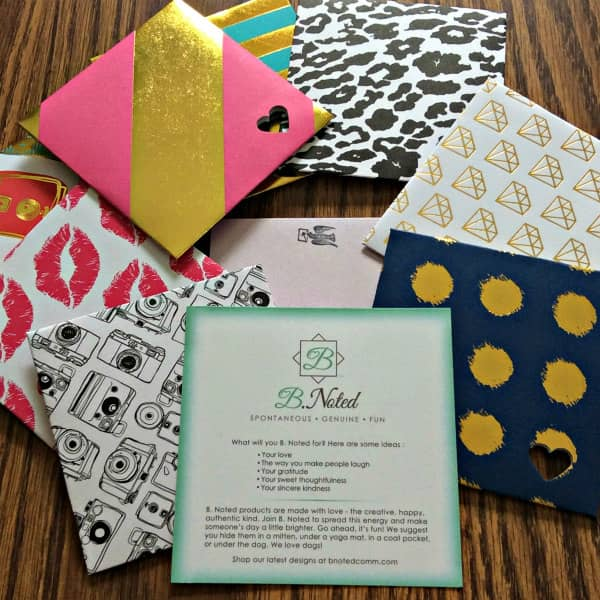 assortment of colorful small square cards and envelopes