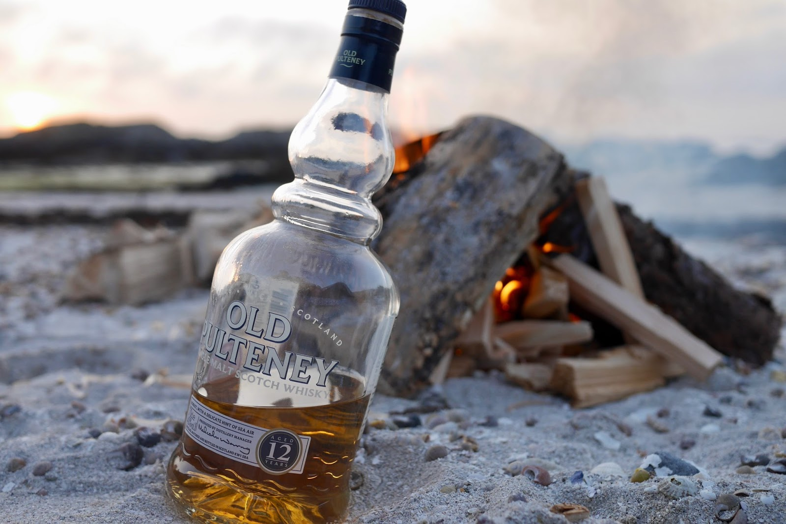 A bottle of old pulteney sitting by the camp fire just itching to be drunk