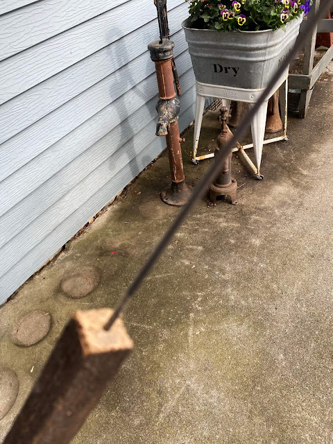 Photo of a round metal rod being added to a garden stake
