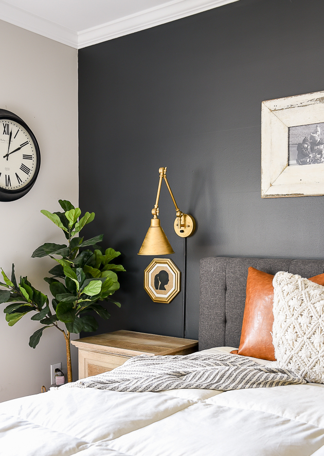 High contrast, dark and moody bedroom, sherwin-williams iron ore, gold scone lights