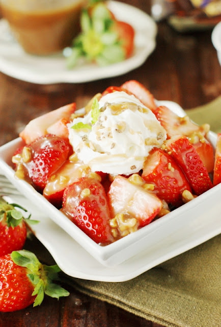 Strawberries with Toffee Sauce ~ Fresh strawberries drizzled with a quick & easy toffee sauce, chock full with toffee bits.  Such a simple and delicious dessert!   www.thekitchenismyplayground.com