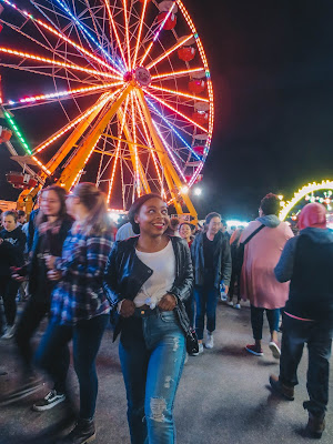 classic, edgy outfit leather jacket and two toned distressed jeans under the ferris wheel