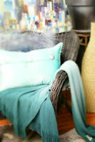 An outdoor wicker chair refinished for indoor use