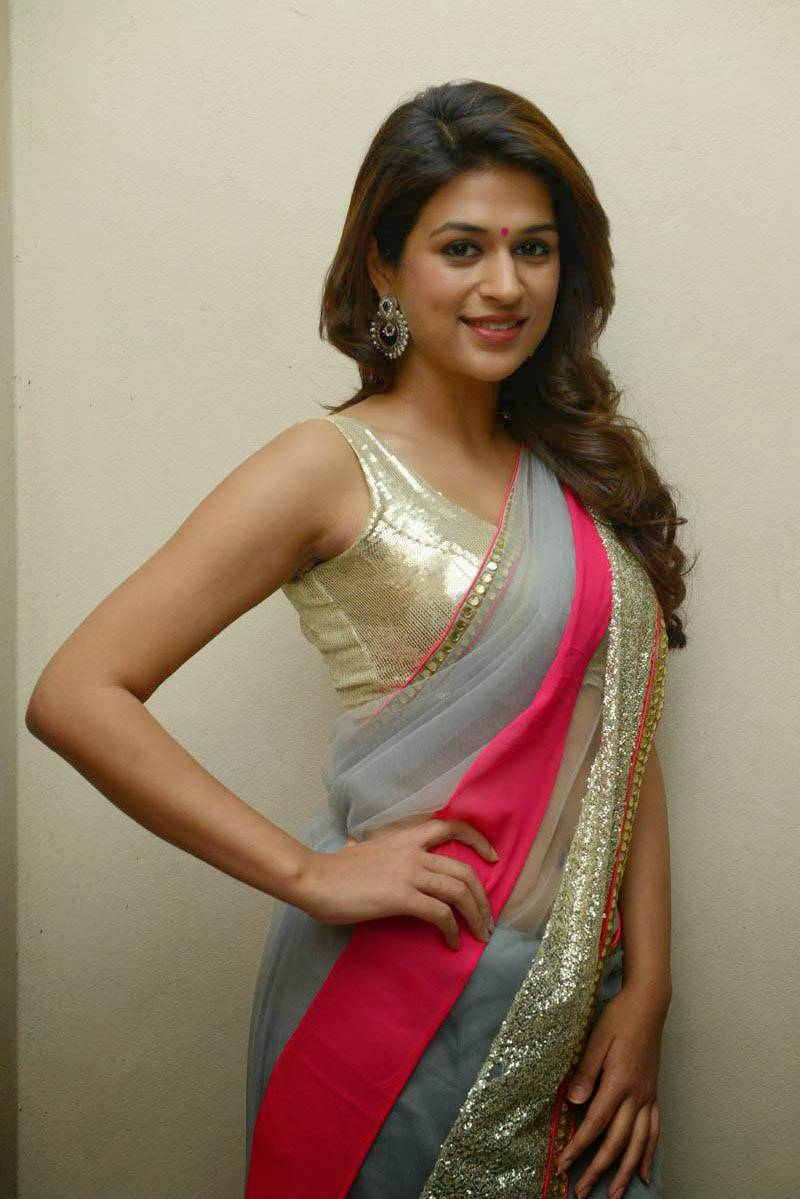 Beautiful Mumbai Girl Shraddha Das Long Hair Stills In Transparent Green Saree