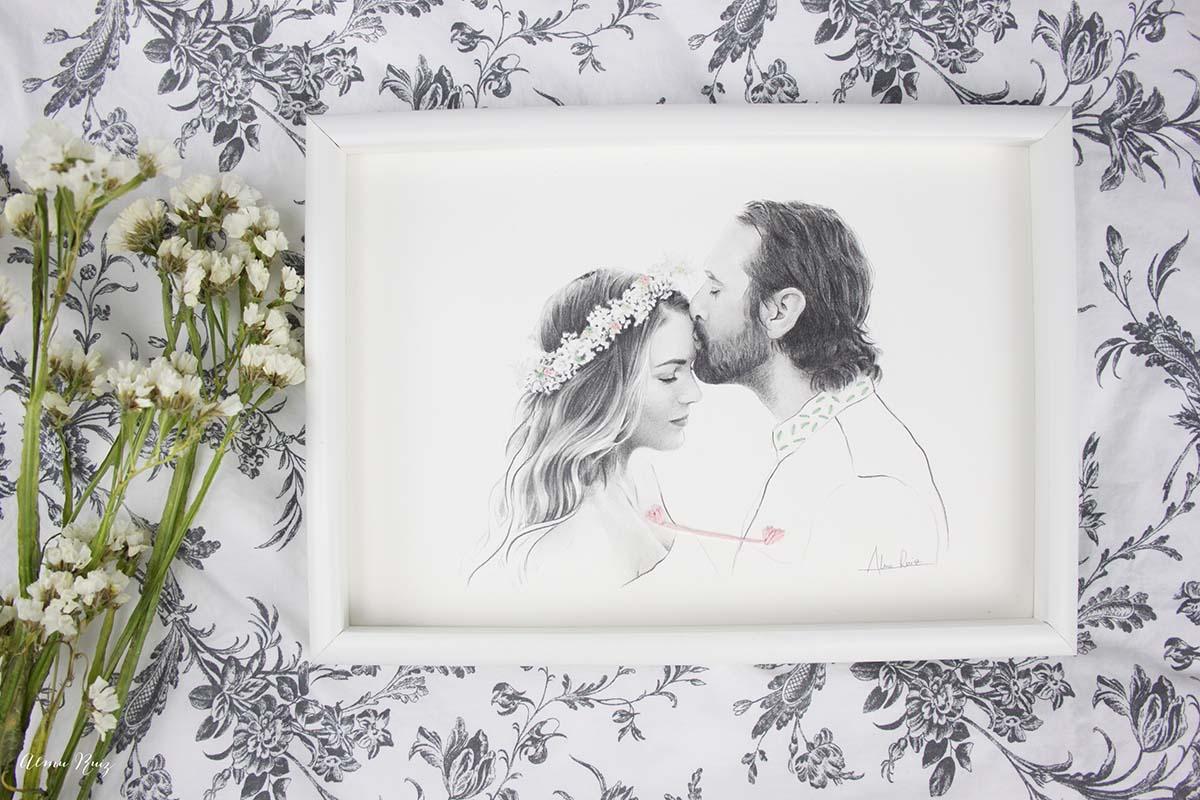 Retrato de pareja dibujado a lápiz y bordados sobre papel