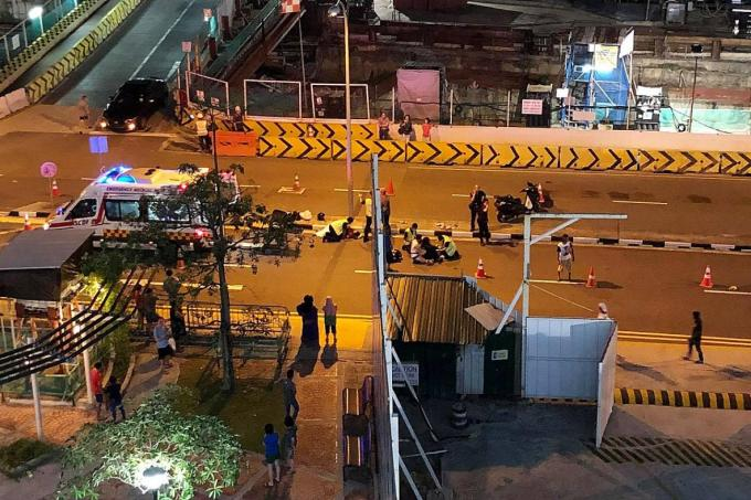 Foreign workers pitched in to direct traffic following an accident involving a car and a motorcycle in Ang Mo Kio Avenue 4 last Saturday night.