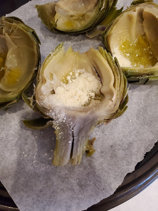 these are artichokes cut in half with butter and herb coating