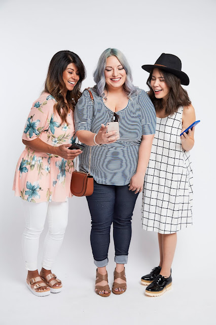 Three ladies downloading Savvi app on their smart phone