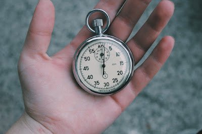 a person holding a stopwatch