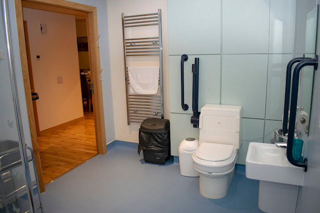 Other side of wet room with toilet, sink and towel heater