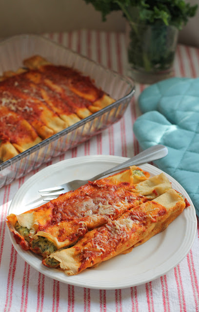 Food Lust People Love: Use your favorite greens to make Greens and Pea Manicotti, a lovely savory vegetarian main course of crepes filled with peas, goat cheese, ricotta and, of course, greens, covered in a fragrant tomato sauce.