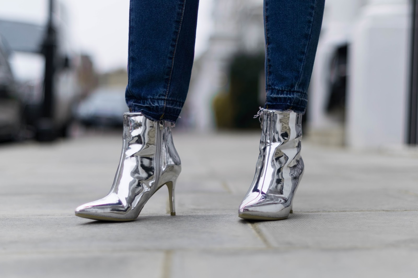 close up image of silver mirror boots