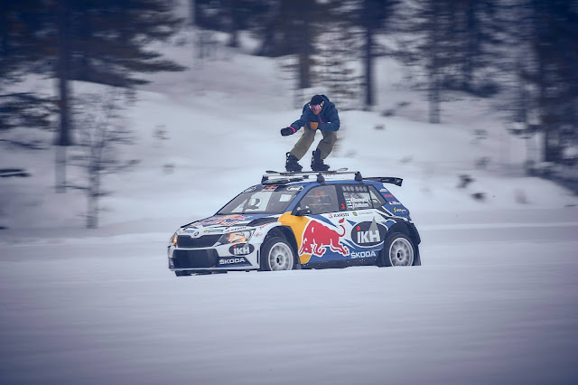 Rally Car and snow boarder on frozen lake