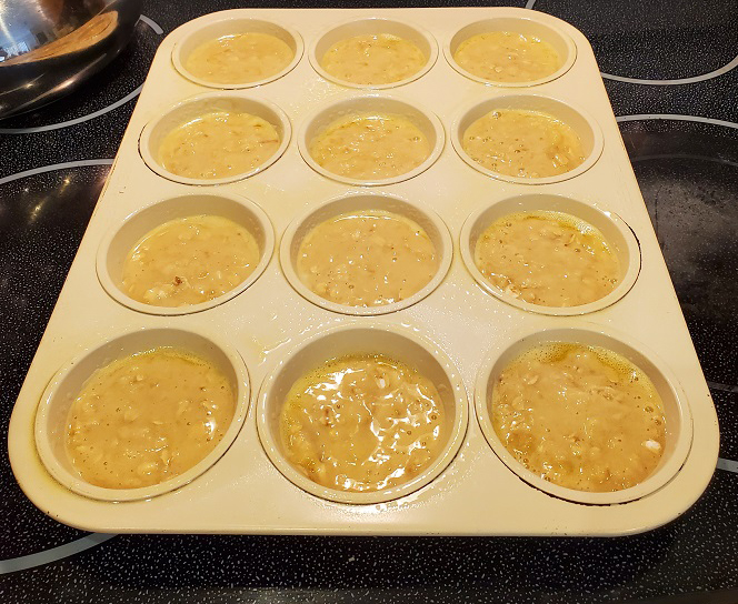 these are Guinness Beer Muffin batter in muffin tins ready to be baked