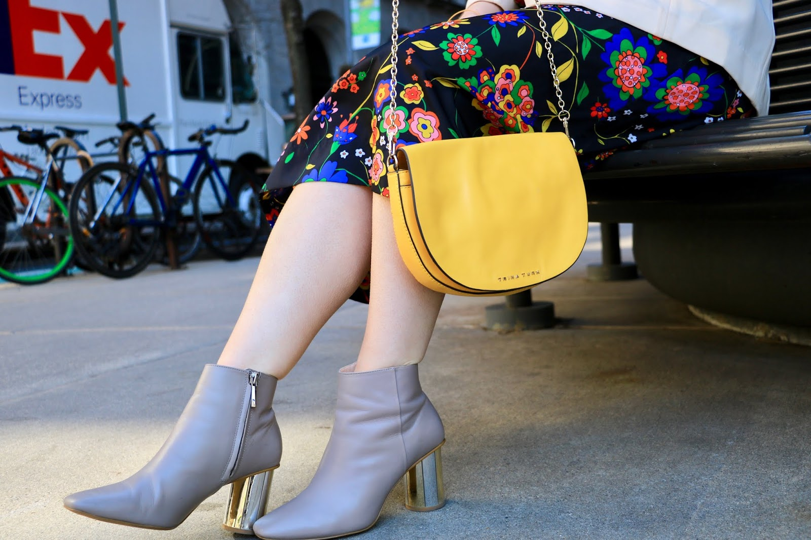 Nyc fashion blogger Kathleen Harper wearing nude booties with a metallic heel