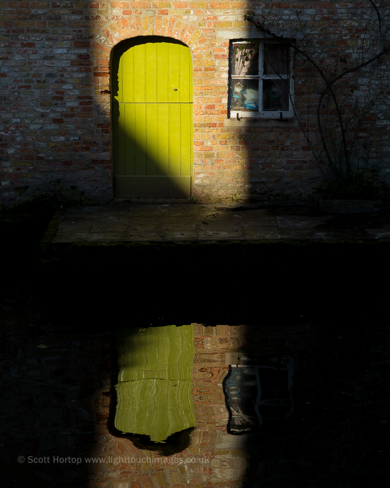 Door reflection - Bruges canal
