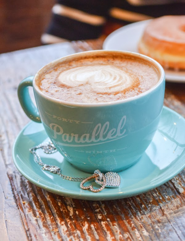 Swarovski Amorous pendant and Forty Ninth Parallel's signature turquoise coffee cup and saucer