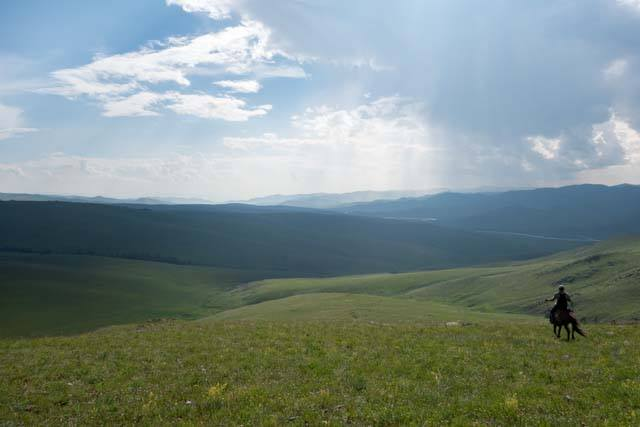 Horse riding on the high steppe of Mongolia