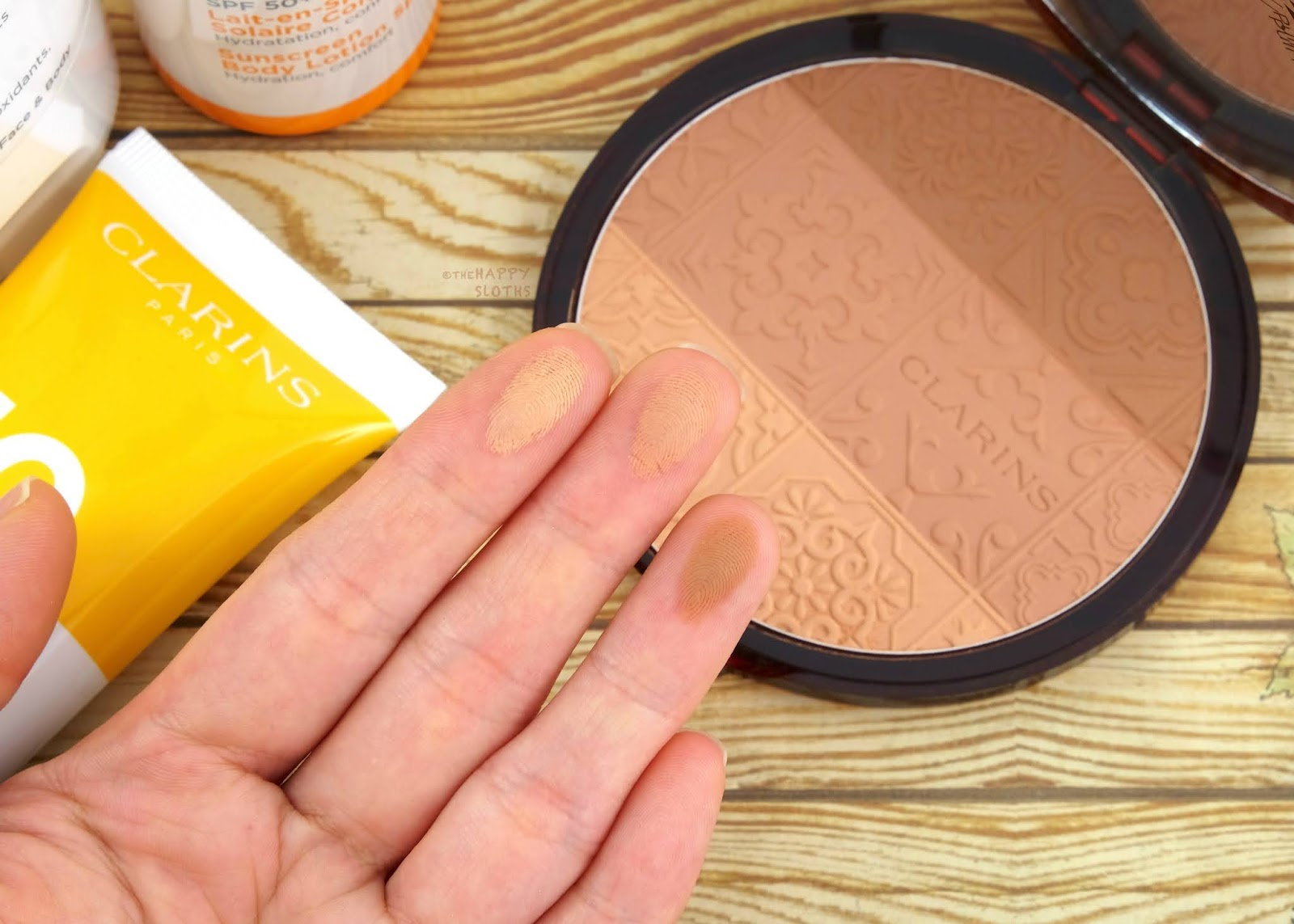 "Clarins | Summer 2020 Bronzing Compact in ""001 Sunset Glow"""