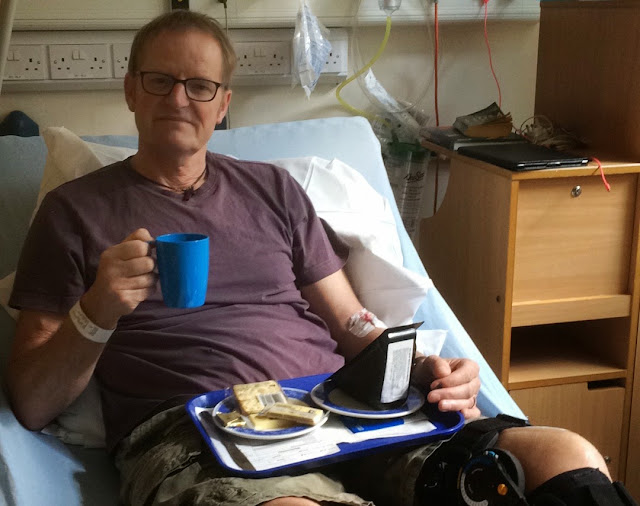 man after knee surgery in NHS bed