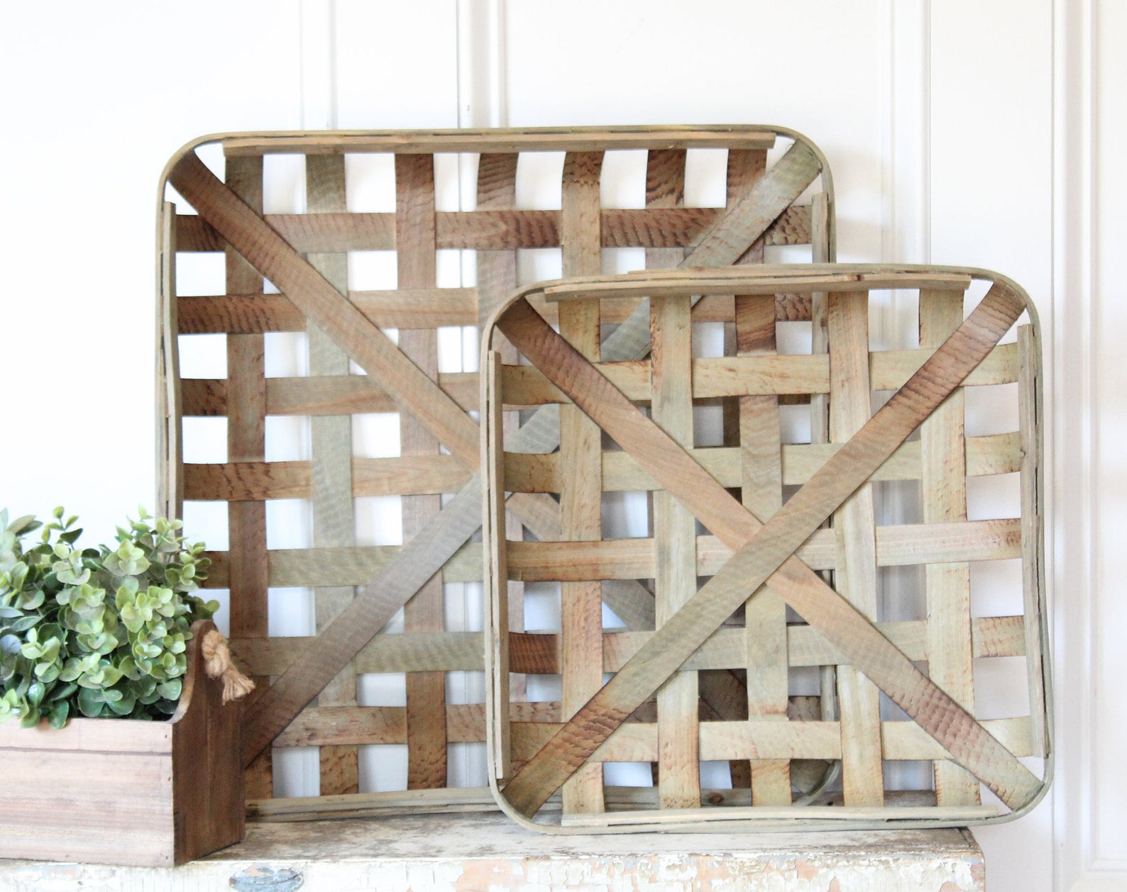 A pair of handmade tobacco baskets add to the vintage aesthetic of a fireplace mantel
