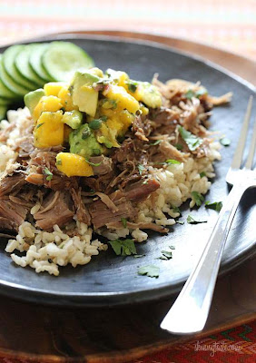 Slow Cooked Jerk Pork with Carribean Salsa from Skinnytaste featured on SlowCookerFromScratch.com