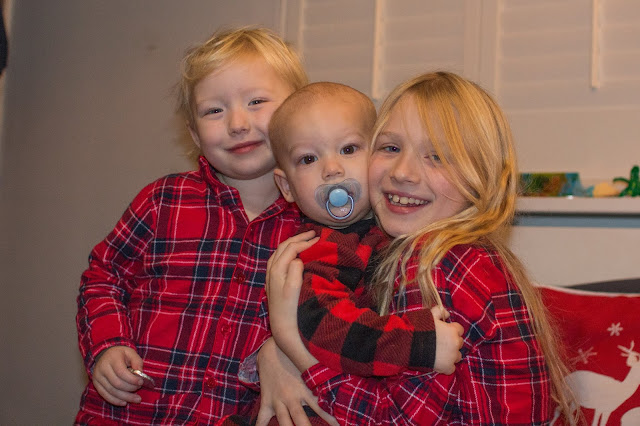 My Trio is Christmas PJs posing for the camera on Christmas morning