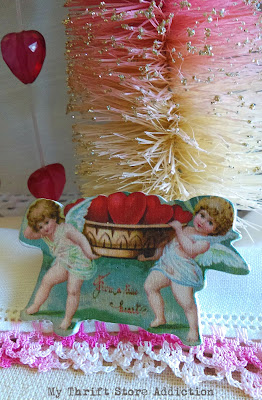 repurposed whimsical cupid diorama
