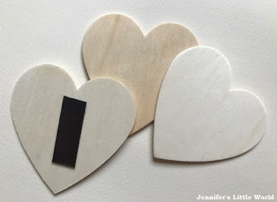Decorated wooden heart magnets for Valentine's Day