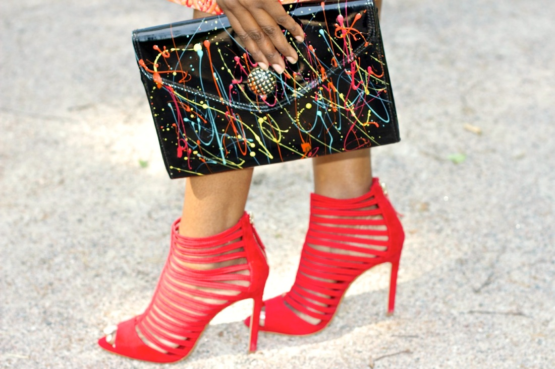 a pair of red Zara heels and patent clutch bag with splash paint detail